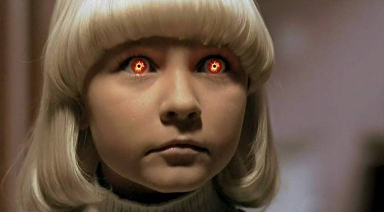 A girl with glowing eyes from the remake of Village of the Damned